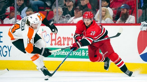 Feb 6, 2018; Raleigh, NC, USA;  Carolina Hurricanes forward Sebastian Aho (20) skates with the puck against Philadelphia Flyers forward Sean Couturier (14) during the third period at PNC Arena. The Philadelphia Flyers defeated the Carolina Hurricanes 2-1 in the overtime. Mandatory Credit: James Guillory-USA TODAY Sports