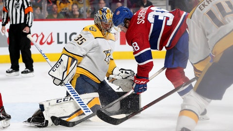 Feb 10, 2018; Montreal, Quebec, CAN; Nashville Predators goaltender Pekka Rinne (35) makes a save against Montreal Canadiens right wing Nikita Scherbak (38) as Nashville defenseman Mattias Ekholm (14) looks on during the second period at Bell Centre. Mandatory Credit: Jean-Yves Ahern-USA TODAY Sport