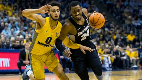 Feb 3, 2018; Milwaukee, WI, USA; Providence Friars guard Kyron Cartwright (24) drives for the basket around Marquette Golden Eagles guard Markus Howard (0) during the second half at BMO Harris Bradley Center. Mandatory Credit: Jeff Hanisch-USA TODAY Sports