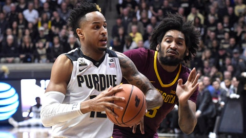 Feb 25, 2018; West Lafayette, IN, USA; Purdue Boilermakers forward Vincent Edwards (12) dribbles the ball past Minnesota Golden Gophers forward Jordan Murphy (3) in the first half at Mackey Arena. Mandatory Credit: Sandra Dukes-USA TODAY Sports