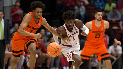 Feb 1, 2018; Stanford, CA, USA; Oregon State Beavers guard Stephen Thompson Jr., left, and Stanford Cardinal guard Daejon Davis pursue a loose ball during the first half of an NCAA men's college basketball game at Maples Pavilion. Mandatory Credit: D. Ross Cameron-USA TODAY Sports