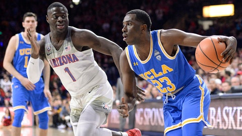 Feb 8, 2018; Tucson, AZ, USA; UCLA Bruins guard Prince Ali (23) drives past Arizona Wildcats guard Rawle Alkins (1) during the first half at McKale Center. Mandatory Credit: Casey Sapio-USA TODAY Sports