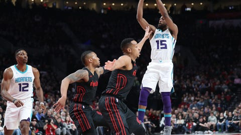 Feb 8, 2018; Portland, OR, USA;  Charlotte Hornets guard Kemba Walker (15) shoots over Portland Trail Blazers guard Damian Lillard (0) and guard CJ McCollum (3) in the first half at Moda Center. Mandatory Credit: Jaime Valdez-USA TODAY Sports