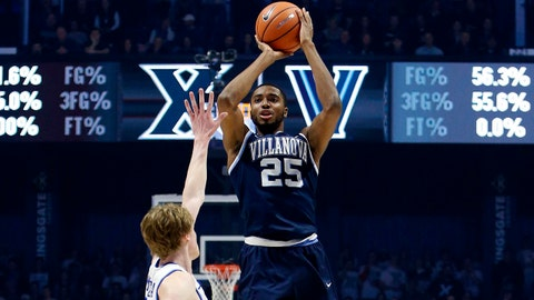 Feb 17, 2018; Cincinnati, OH, USA; Villanova Wildcats guard Mikal Bridges (25) shoots during the first half against the Xavier Musketeers guard J.P. Macura (55) at the Cintas Center. Mandatory Credit: Frank Victores-USA TODAY Sports