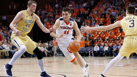 Feb 21, 2018; Charlottesville, VA, USA; Virginia Cavaliers guard Ty Jerome (11) dribbles the ball between Georgia Tech Yellow Jackets center Ben Lammers (44) and Yellow Jackets forward Evan Cole (3) during the second half at John Paul Jones Arena. Mandatory Credit: Amber Searls-USA TODAY Sports