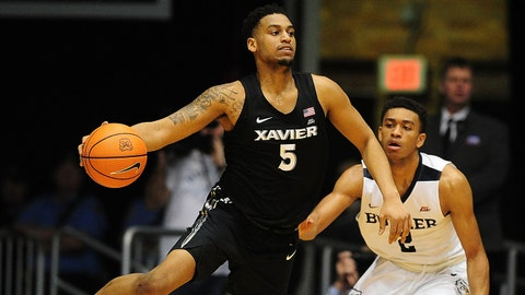 Feb 6, 2018; Indianapolis, IN, USA; Xavier Musketeers guard Trevon Bluiett (5) makes a pass over Butler Bulldogs guard Aaron Thompson (2) in the first half at Hinkle Fieldhouse. Mandatory Credit: Thomas J. Russo-USA TODAY Sports