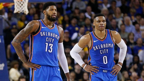Feb 6, 2018; Oakland, CA, USA; Oklahoma City Thunder forward Paul George (13) and guard Russell Westbrook (0) stand on the court during a free throw attempt against the Golden State Warriors in the second quarter at Oracle Arena. Mandatory Credit: Cary Edmondson-USA TODAY Sports