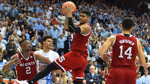 Jan 27, 2018; Chapel Hill, NC, USA; North Carolina State Wolfpack guard Allerik Freeman (12) with the ball in overtime at Dean E. Smith Center. Mandatory Credit: Bob Donnan-USA TODAY Sports