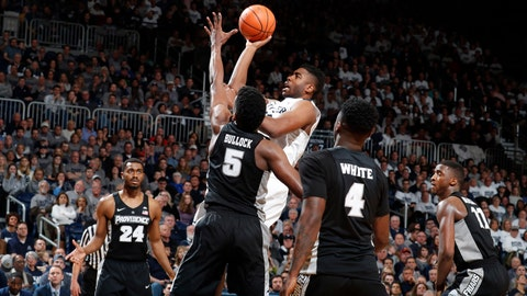 Feb 17, 2018; Indianapolis, IN, USA; Butler Bulldogs forward Kelan Martin (30) takes a shot against Providence Friars forward Rodney Bullock (5) during the second half at Hinkle Fieldhouse. Mandatory Credit: Brian Spurlock-USA TODAY Sports