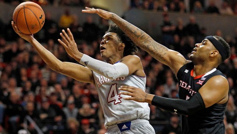 Kansas clinches share of 14th straight Big 12 title with 74-72 win over Texas Tech