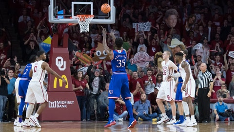 Jayhawks blast Sooners as Young's struggles continue