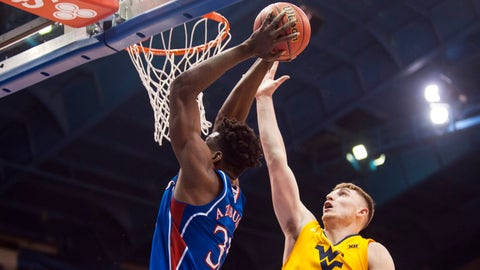 Feb 17, 2018; Lawrence, KS, USA; West Virginia Mountaineers forward Logan Routt (31) tries to block a shot by Kansas Jayhawks center Udoka Azubuike (35) in the second half at Allen Fieldhouse. Mandatory Credit: Amy Kontras-USA TODAY Sports