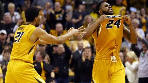 Feb 10, 2018; Columbia, MO, USA; Missouri Tigers forward Kevin Puryear (24) and Missouri Tigers forward Jordan Barnett (21) celebrate in overtime against the Mississippi State Bulldogs at Mizzou Arena. Mandatory Credit: Jay Biggerstaff-USA TODAY Sports