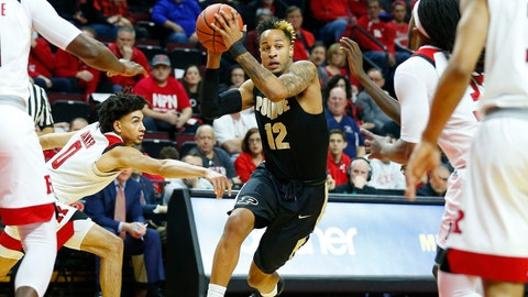 Feb 3, 2018; Piscataway, NJ, USA; Purdue Boilermakers forward Vincent Edwards (12) drives to the basket against Rutgers Scarlet Knights defenders during first half at Louis Brown Athletic Center. Mandatory Credit: Noah K. Murray-USA TODAY Sports