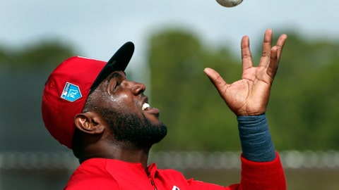 St. Louis Cardinals outfielder Marcell Ozuna practices catching a ball with his bare hand during spring training baseball practice Tuesday, Feb. 20, 2018, in Jupiter, Fla. (AP Photo/Jeff Roberson)