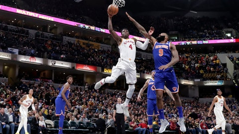 Indiana Pacers guard Victor Oladipo (4) shoots in front of New York Knicks center Kyle O'Quinn (9) during the second half of an NBA basketball game in Indianapolis, Sunday, Feb. 11, 2018. The Pacers defeated the Knicks 121-113. (AP Photo/Michael Conroy)