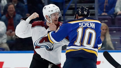 Colorado Avalanche's Gabriel Landeskog, of Sweden, and St. Louis Blues' Brayden Schenn (10) fight during the first period of an NHL hockey game Thursday, Feb. 8, 2018, in St. Louis. (AP Photo/Jeff Roberson)