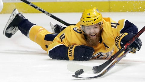 Nashville Predators defenseman Ryan Ellis reaches out to deflect the puck in the first period of an NHL hockey game against the Calgary Flames, Thursday, Feb. 15, 2018, in Nashville, Tenn. (AP Photo/Mark Humphrey)