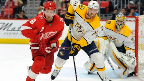 Detroit Red Wings left wing Justin Abdelkader (8) is guarded by Nashville Predators defenseman Mattias Ekholm (14) in the second period of an NHL hockey game, Tuesday, Feb. 20, 2018, in Detroit. (AP Photo/Jose Juarez)