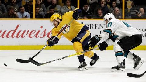 Nashville Predators left wing Viktor Arvidsson, of Sweden, shoots as he is defended by San Jose Sharks' Joakim Ryan (47) in the second period of an NHL hockey game Thursday, Feb. 22, 2018, in Nashville, Tenn. (AP Photo/Mark Humphrey)
