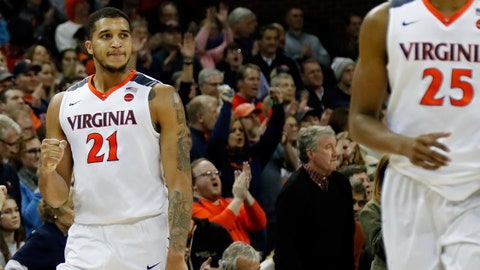 Jan 31, 2018; Charlottesville, VA, USA; Virginia Cavaliers forward Isaiah Wilkins (21) celebrates on the court in the final seconds of the second half against the Louisville Cardinals at John Paul Jones Arena. The Cavaliers won 74-64. Mandatory Credit: Geoff Burke-USA TODAY Sports