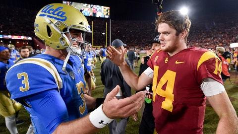 Nov 18, 2017; Los Angeles, CA, USA; Southern California Trojans quarterback Sam Darnold (right) and UCLA Bruins quarterback Josh Rosen (3) shake hands after their game at Los Angeles Memorial Coliseum. Mandatory Credit: Kelvin Kuo-USA TODAY Sports
