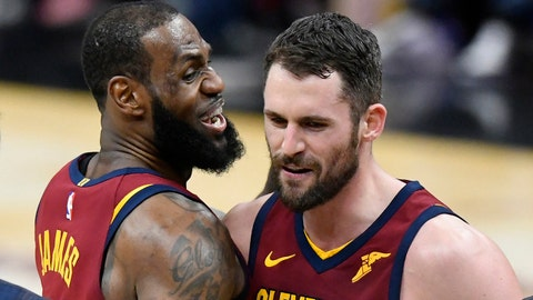Mar 21, 2018; Cleveland, OH, USA; Cleveland Cavaliers center Kevin Love (0) celebrates his three-point basket with forward LeBron James (23) in the fourth quarter against the Toronto Raptors at Quicken Loans Arena. Mandatory Credit: David Richard-USA TODAY Sports