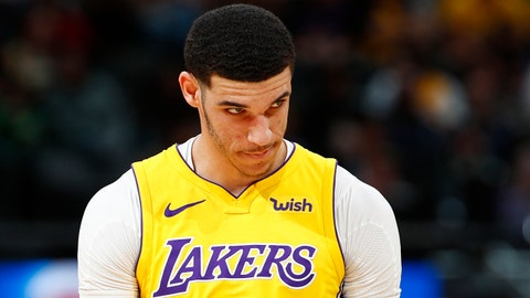 Los Angeles Lakers guard Lonzo Ball reacts after missing a pass from guard Isaiah Thomas during the first half of the team's NBA basketball game against the Denver Nuggets on Friday, March 9, 2018, in Denver. (AP Photo/David Zalubowski)