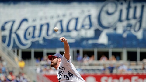 Kansas City Royals relief pitcher Travis Wood throws during the first inning of a baseball game against the Minnesota Twins, Sunday, July 2, 2017, in Kansas City, Mo. (AP Photo/Charlie Riedel)