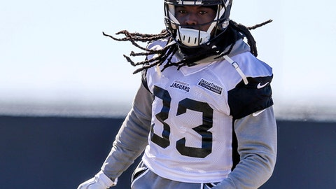 Jacksonville Jaguars running back Chris Ivory (33) takes part in a drill during an NFL football practice in Jacksonville, Fla., Thursday, Jan. 18, 2018. (AP Photo/Gary McCullough)