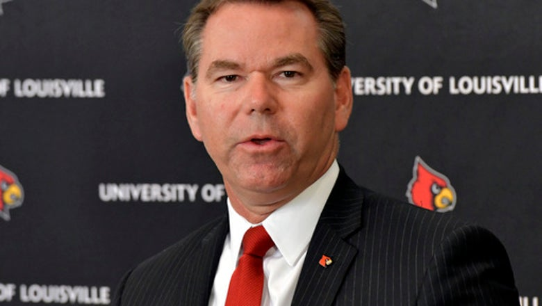 Louisville promotes Tyra to permanent athletic director