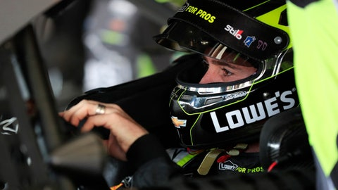 NASCAR Cup Series driver Jimmie Johnson (48) waits to practice for Sunday's NSCAR Cup series auto race at Atlanta Motor Speedway in Hampton, Ga., on Saturday, Feb. 24, 2018. (AP Photo/Paul Abell)