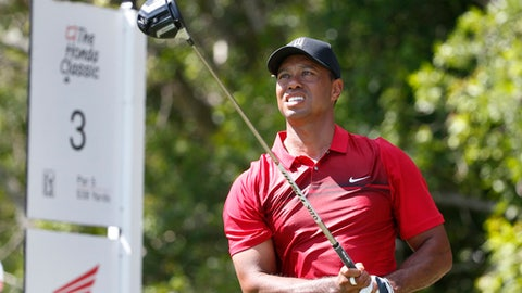 Tiger Woods tees off on the third hole during the final round of the Honda Classic golf tournament, Sunday, Feb. 25, 2018, in Palm Beach Gardens, Fla. (AP Photo/Wilfredo Lee)