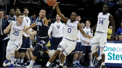 Villanova guard Jalen Brunson (1) and Seton Hall guard Khadeen Carrington (0) compete for the ball during the first half of an NCAA college basketball game, Wednesday, Feb. 28, 2018, in Newark, N.J. (AP Photo/Julio Cortez)