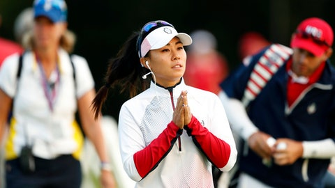 FILE - In this Aug. 18, 2017 file photo, Danielle Kang of the United States, walks to the practice green before her foursome match in the Solheim Cup golf tournament, in West Des Moines, Iowa.  Danielle Kang recovered from a bizarre mishap that left her nursing a broken tooth to charge up the leaderboard on the opening day of the LPGA Singapore tournament on Thursday, March 1, 2018. The reigning Womens PGA Championship title holder, Kang said she fell asleep while exercising ahead of her opening round, and woke up feeling pain in her mouth.(AP Photo/Charlie Neibergall, File)