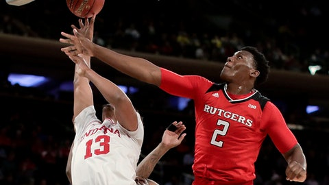 Indiana forward Juwan Morgan (13) shoots against Rutgers center Shaquille Doorson (2) during the first half of an NCAA college basketball game in the Big Ten mens tournament Thursday, March 1, 2018, in New York. (AP Photo/Julie Jacobson)