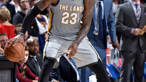 CLEVELAND, OH - MARCH 1:  LeBron James #23 of the Cleveland Cavaliers handles the ball against the Philadelphia 76ers on March 1, 2018 at Quicken Loans Arena in Cleveland, Ohio. (Photo by David Liam Kyle/NBAE via Getty Images)