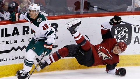 Minnesota Wild defenseman Jared Spurgeon (46) checks Arizona Coyotes right wing Richard Panik, right, to the ice during the second period of an NHL hockey game Thursday, March 1, 2018, in Glendale, Ariz. (AP Photo/Ross D. Franklin)