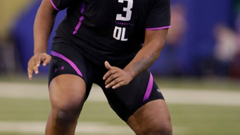 Oklahoma offensive lineman Orlando Brown runs a drill at the NFL football scouting combine in Indianapolis, Friday, March 2, 2018. (AP Photo/Michael Conroy)