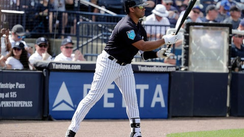 New York Yankees pinch hitter Russell Wilson, a Seattle Seahawks quarterback, warms up on deck before batting during the fifth inning of a baseball spring exhibition game against the Atlanta Braves, Friday, March 2, 2018, in Tampa, Fla. (AP Photo/Lynne Sladky)