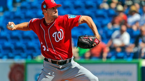 Washington Nationals starting pitcher Max Scherzer throws during the first inning of an exhibition spring training baseball game against the New York Mets, Friday, March 2, 2018, in Port St. Lucie, Fla. (AP Photo/Jeff Roberson)