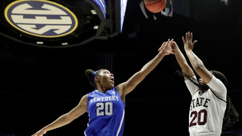 Mississippi State guard Nyah Tate, right, shoots over Kentucky center Dorie Harrison, left, in the second half of an NCAA college basketball game at the women's Southeastern Conference tournament Friday, March 2, 2018, in Nashville, Tenn. Mississippi State won 81-58. (AP Photo/Mark Humphrey)