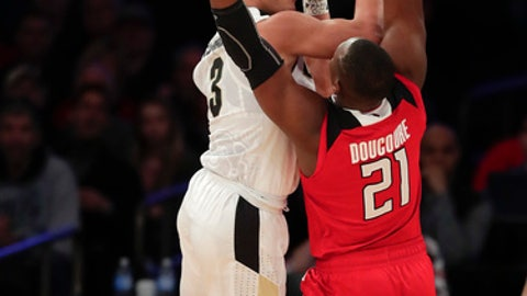 Purdue guard Carsen Edwards (3) puts up a shot against Rutgers forward Mamadou Doucoure (21) during the first half of an NCAA Big Ten Conference tournament college basketball game, Friday, March 2, 2018, in New York. (AP Photo/Julie Jacobson)