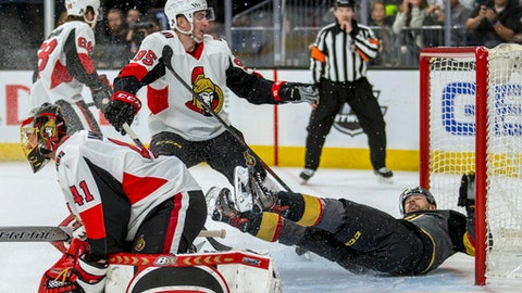 Vegas Golden Knights left wing Tomas Tatar (90) is sent into the net by Ottawa Senators center Matt Duchene (95), who was penalized during the second period of an NHL hockey game Friday, March 2, 2018, in Las Vegas. (AP Photo/L.E. Baskow)