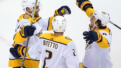 Nashville Predators' Mike Fisher, Anthony Bitetto and Viktor Arvidsson, from left, celebrate Fisher's goal against the Vancouver Canucks during the second period of an NHL hockey game Friday, March 2, 2018, in Vancouver, British Columbia. (Darryl Dyck/The Canadian Press via AP)