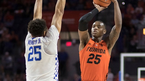 Florida forward Keith Stone (25) puts up a shot over Kentucky forward PJ Washington (25) during the first half of an NCAA college basketball game in Gainesville, Fla., Saturday, March 3, 2018. (AP Photo/Ron Irby)