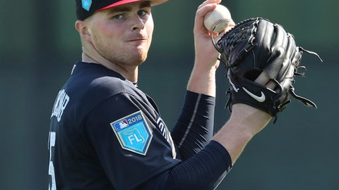 FILE - In this Feb. 16, 2018, file photo, Atlanta Braves pitcher Sean Newcomb loosens up during baseball spring training practice in Lake Buena Vista, Fla. Teammates Dansby Swanson and Sean Newcomb are hoping to rebound from rocky seasons. (Curtis Compton/Atlanta Journal-Constitution via AP, File)