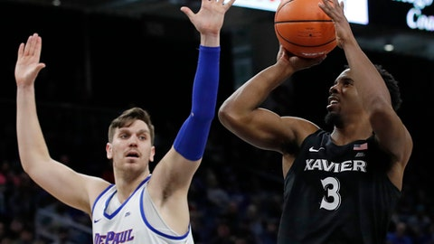 Xavier guard Quentin Goodin (3) shoots against DePaul center Marin Maric (34) during the second half of an NCAA college basketball game Saturday, March 3, 2018, in Chicago, Ill. (AP Photo/Jim Young)