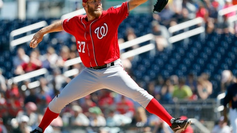 Washington Nationals starting pitcher Stephen Strasburg throws during the first inning of an exhibition spring training baseball game against the Houston Astros, Saturday, March 3, 2018, in West Palm Beach, Fla. (AP Photo/Jeff Roberson)