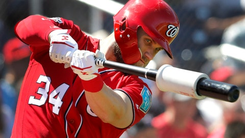Washington Nationals' Bryce Harper swings in the on-deck circle as he prepares to bat during the fourth inning of an exhibition spring training baseball game against the Houston Astros, Saturday, March 3, 2018, in West Palm Beach, Fla. (AP Photo/Jeff Roberson)